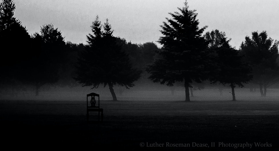 There is a chair, alone, in an empty and wide open space. - Yesterday morning, the fog moved, and hovered to distort over a road, and across a landscape,...