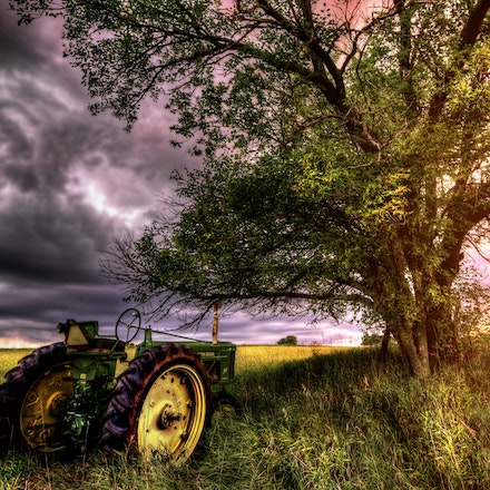 Hi...I'm John Deere    9.7.2016.3 - Hi...I'm John Deere. A  John Deere tractor rests in the shadow of a stately tree in Lancaster County, NE. #plants #nebraska...