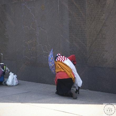 Lady Praying - Washington D.C., USA -  October 10, 2008: A homeless woman struggles on the streets of Washington.