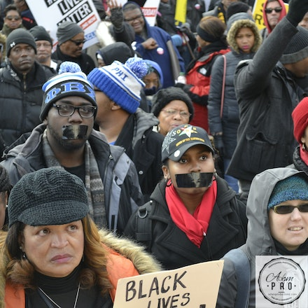 We Have No Voice - Washington DC, USA, Dec 13, 2014: Protesters tape their mouths shut showing 'We have no voice' about police killing unarmed black men....