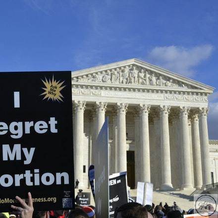 Regret - Washington D.C., USA, Jan 22, 2015: A woman holds a sign at the U.S. Supreme Court.