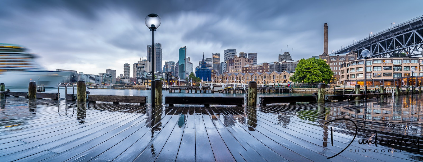 Circular Quay Panorama - Dawn at Circular Quay, looking towards Sydney CBD. Explorer of the Seas cruise ship just muscled into the shot on the left, as...